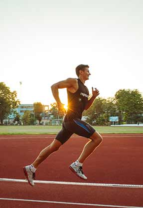 Athletic man running on race track after float therapy session