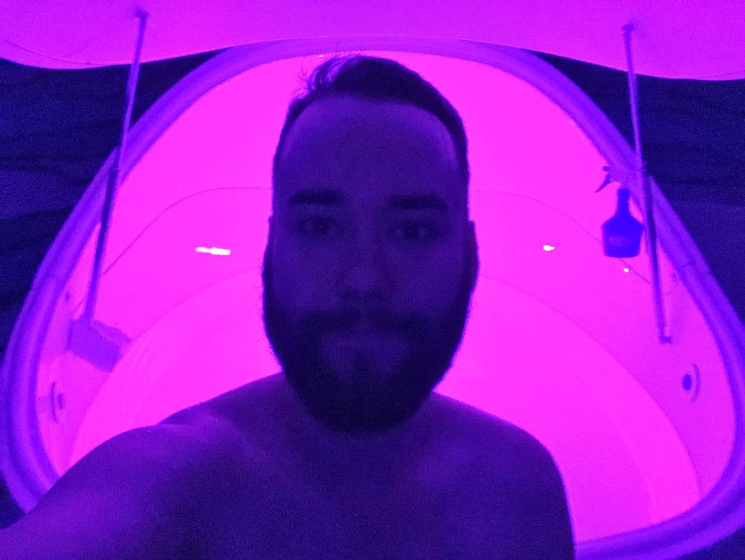 Man standing outside of isolation tank in London float centre